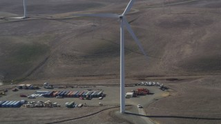 JDC01_070 - 5K stock footage aerial video of cargo containers and Shiloh Wind Power Plant windmill, Montezuma Hills, California