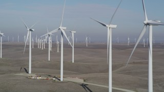 JDC01_073 - 5K stock footage aerial video of flying by rows of windmills, Shiloh Wind Power Plant, Montezuma Hills, California
