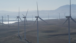 JDC01_075 - 5K stock footage aerial video of flying by a row of windmills, Shiloh Wind Power Plant, Montezuma Hills, California