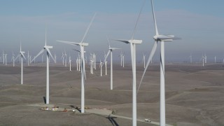 JDC01_076 - 5K stock footage aerial video of flying by a row of windmills, Shiloh Wind Power Plant, Montezuma Hills, California