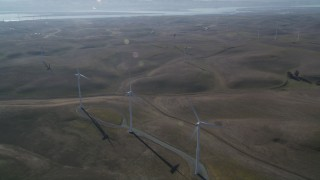 JDC01_077 - 5K stock footage aerial video of flying by a row of windmills, Shiloh Wind Power Plant, Montezuma Hills, California