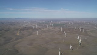 JDC01_080 - 5K stock footage aerial video of hilly field of windmills, Shiloh Wind Power Plant, Montezuma Hills, California