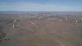 JDC01_081 - 5K stock footage aerial video of a hilly field with windmills, Shiloh Wind Power Plant, Montezuma Hills, California