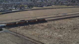 JDC01_085 - 5K stock footage aerial video track train past fields and residential neighborhoods, Pittsburg, California