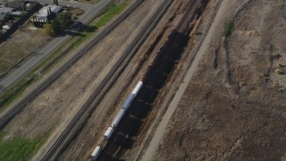 JDC01_086 - 5K stock footage aerial video of tracking a train moving past residential neighborhoods, fields, Pittsburg, California