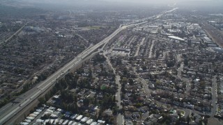 JDC01_089 - 5K stock footage aerial video of flying by a freeway and suburban neighborhoods, Concord, California