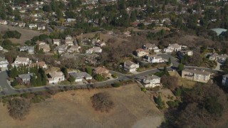 JDC02_003 - 5K stock footage aerial video of flying away from suburban tract homes and hills, Lafayette, California