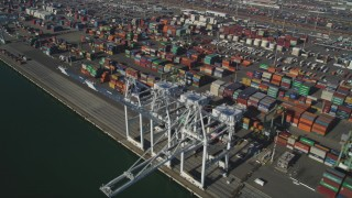 JDC02_011 - 5K stock footage aerial video of flying by shipping containers, cargo cranes at Port of Oakland, California