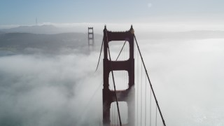 JDC02_016 - 5K stock footage aerial video of orbiting Golden Gate Bridge shrouded in fog, San Francisco, California