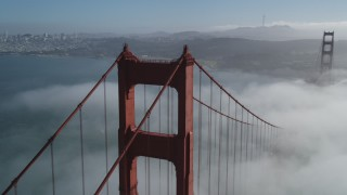 JDC02_017 - 5K stock footage aerial video orbit the Golden Gate Bridge and fog, reveal Alcatraz and Downtown San Francisco, California