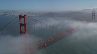 JDC02_025 - 5K stock footage aerial video fly over Marin Hills, reveal famous and iconic Golden Gate Bridge in fog, San Francisco, California