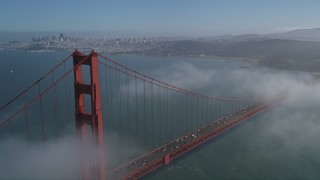 JDC02_026 - 5K stock footage aerial video approach the city while flying over the Golden Gate Bridge, Downtown San Francisco, California