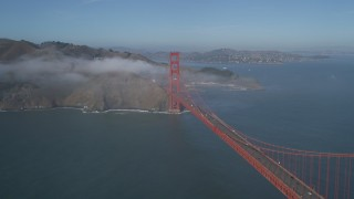 JDC02_027 - 5K stock footage aerial video of flying by the world famous Golden Gate Bridge with light fog, San Francisco, California