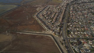 JDC03_003 - 5K stock footage aerial video of flying away from tract homes and marshland, Union City, California