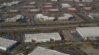 JDC03_004 - 5K stock footage aerial video of flying away from office buildings and warehouses, Newark, California