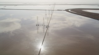 JDC03_007 - 5K stock footage aerial video of following a row of power lines and marshlands, Fremont, California