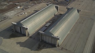 JDC03_021 - 5K stock footage aerial video tilt to reveal Hangar Two, Hangar Three at Moffett Field military base, Mountain View, California