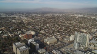 JDC04_009 - 5K stock footage aerial video of flying over downtown to approach urban neighborhoods, Downtown San Jose, California