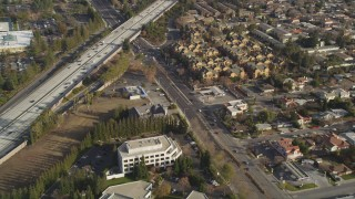 JDC04_013 - Aerial stock footage of 5K aerial view of a reverse view of 280 freeway, apartment buildings, office buildings, Cupertino, California