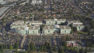 JDC04_019 - 5K stock footage aerial video of flying away from Apple Headquarters office buildings, Cupertino, California