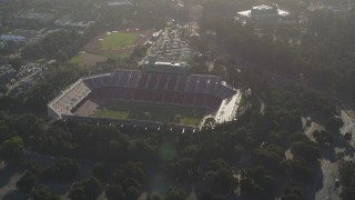 JDC04_024 - 5K stock footage aerial video tilt from Stanford Stadium, reveal Stanford University and Hoover Tower, Stanford, California