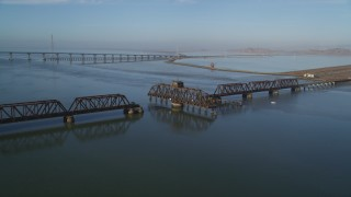 JDC04_034 - 5K stock footage aerial video of flying by a railroad bridge, Dumbarton Bridge, San Francisco Bay, California