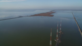 JDC04_036 - 5K stock footage aerial video of flying by wetlands, tilt down revealing radio towers, Fremont, California