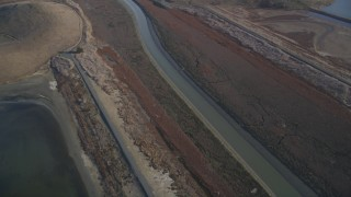 JDC04_038 - 5K stock footage aerial video of flying away from marshland, Union City, California