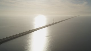 JDC04_040 - 5K stock footage aerial video of flying by San Mateo Bridge, sun reflecting off San Francisco Bay, California