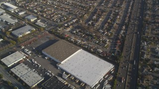 JDC04_041 - 5K stock footage aerial video fly away from suburban neighborhoods, warehouses by I-880 freeway, San Leandro, California