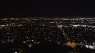 LD01_0001 - 5K stock footage aerial video of lifting off from Hawthorne Municipal Airport, California at night