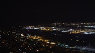 LD01_0005 - 5K stock footage aerial video passenger jet take off at night from LAX (Los Angeles International Airport), California