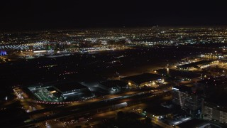 LD01_0006 - 5K stock footage aerial video track a passenger jet landing at night, LAX (Los Angeles International Airport), California