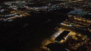 LD01_0007 - 5K stock footage aerial video track a jet landing at night, LAX (Los Angeles International Airport), California