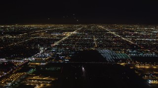 LD01_0008 - 5K stock footage aerial video tilt from runway to reveal approaching jet at night, LAX (Los Angeles International Airport), California
