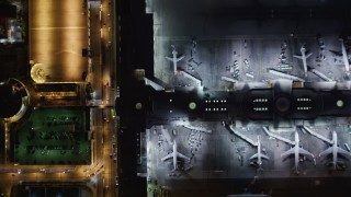 LD01_0014 - 5K stock footage aerial video a bird's eye of LAX (Los Angeles International Airport), California at night