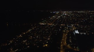 LD01_0022 - 5K stock footage aerial video pan across and fly over Venice, California at night