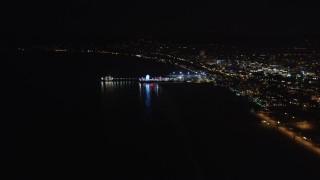 LD01_0025 - 5K stock footage aerial video approach the pier at night, Santa Monica, California