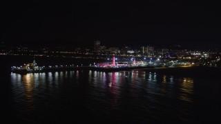 LD01_0026 - 5K stock footage aerial video orbit the pier at night in Santa Monica, California