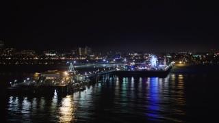 LD01_0027 - 5K stock footage aerial video an orbit of Santa Monica Pier, California at nighttime