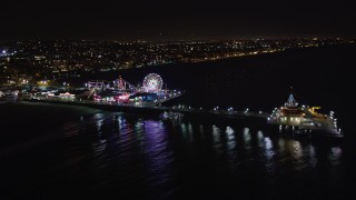 LD01_0028 - 5K stock footage aerial video of the Santa Monica Pier, California at night
