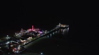 LD01_0029 - 5K stock footage aerial video of circling Santa Monica Pier, California at night
