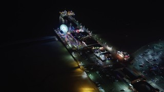 LD01_0031 - 5K stock footage aerial video of flying around the Santa Monica Pier, California at night
