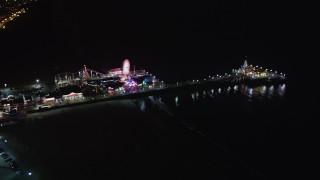 LD01_0032 - 5K stock footage aerial video orbit around Santa Monica Pier, California at night