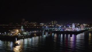 LD01_0034 - 5K stock footage aerial video circling around the end of the Santa Monica Pier, California at night