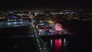LD01_0041 - 5K stock footage aerial video tilt to reveal and approach Santa Monica Pier, California at night