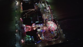 LD01_0042 - 5K stock footage aerial video tilt to a bird's eye of the Ferris wheel at Santa Monica Pier, California at night