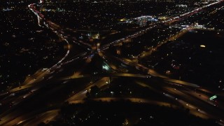 LD01_0044 - 5K stock footage aerial video pan across freeway at night to reveal interchange, West Los Angeles, California