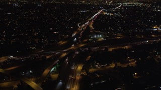 LD01_0045 - 5K aerial stock footage video light traffic on freeway interchange at night, West Los Angeles, California