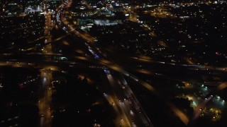 LD01_0046 - 5K stock footage aerial video orbit a freeway interchange at night in West Los Angeles, California
